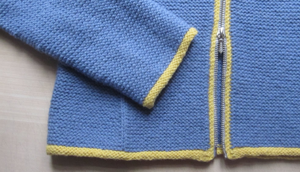 Detail of hand knitted jacket in garter stitch