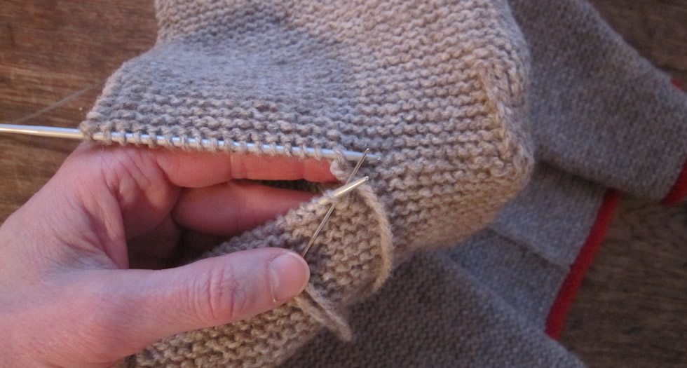 Grafting knit stitches together in garter stitch to form a hood