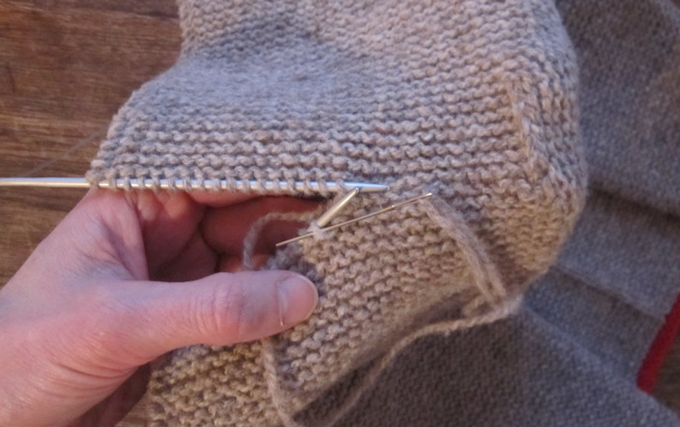 grafting knit stitches together invisibly in garter stitch to form a hood