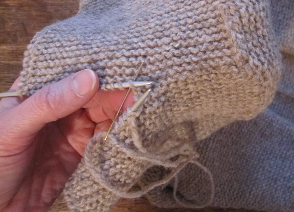 grafting stitches together invisibly in garter stitch to form a hood