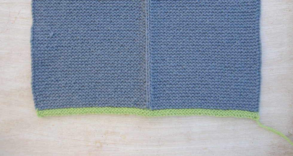 Knitted bavarian jacket sample in light blue and spring green
